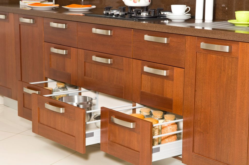 Kitchen with lots of storage hidden behind cabinet doors and in drawers.