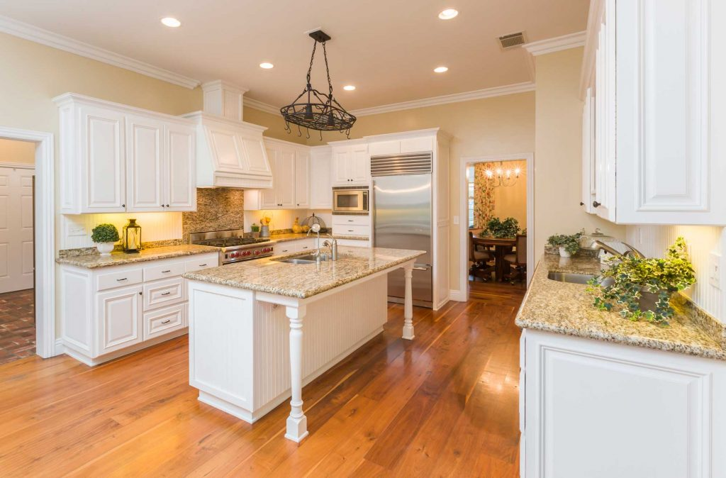 Elegant kitchen update with large island including a sink.