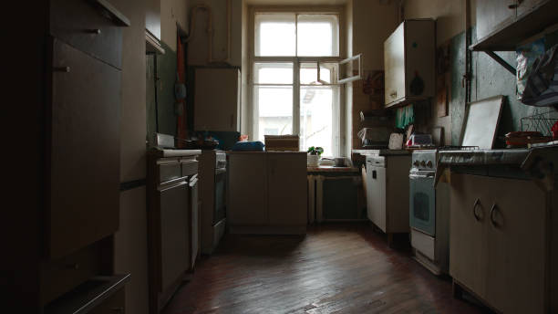 An old kitchen that is dark and outdated