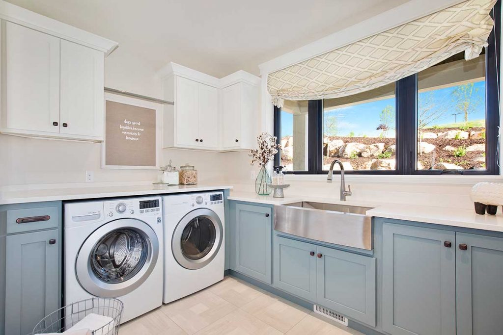 Bright open laundry room with a farmhouse sink and lots of counterspace