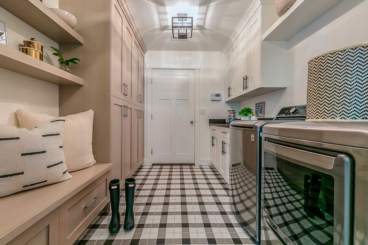 Laundry room with a storage bench